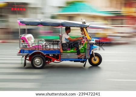 traditional tuk-tuk from Bangkok, Thailand, in motion blur