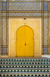 Traditional Tunisian door with tiles and ornament as symbol of Tunisia