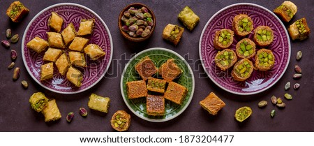 Traditional turkish, arabic sweets baklava assortment with pistachio. Top view, copy space. Banner