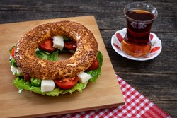 Traditional Turkish breakfast with Turkish bagel simit on the table. Food concept on the table at the restaurant.