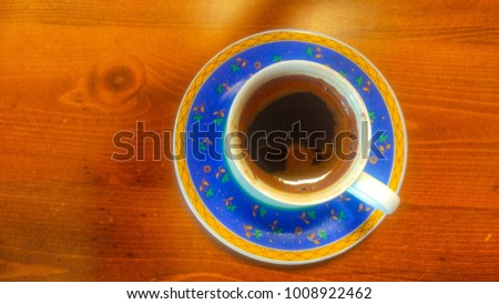 Traditional Turkish Coffee more foam blue coffee cup top view on brown wood table background. Nostalgic turkish coffee fortune is best tourist drink