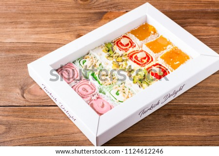 Traditional Turkish Delight in a box on a wooden table Stockfoto ©