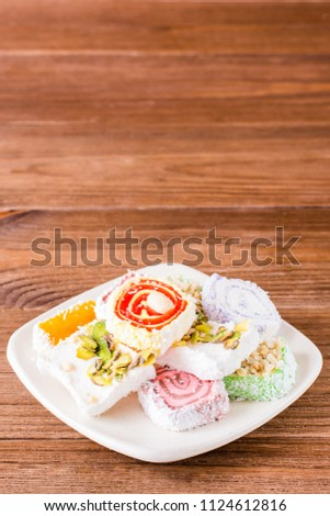 Traditional Turkish Delight on a plate on a wooden table Stockfoto ©
