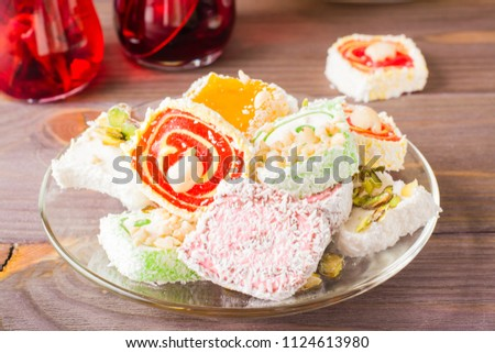 Traditional Turkish Delight on a saucer  on a wooden table Stockfoto ©