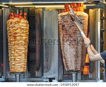 Traditional turkish foods, chicken doner and meat doner kebap in Istanbul, Turkey. Doner kebab (also döner kebab) is a type of kebab, made of meat cooked on a vertical rotisserie.