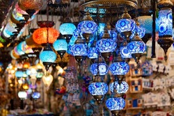 Traditional Turkish lamps made of colored glass. Oriental lamps in a souvenir shop, Turkey. Selective focus.