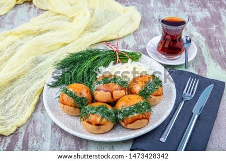 Traditional Turkish pastry pogaca with cheese filling with dill. Turkish name: Sakalli, sacakli, corek - pogaca. Stok fotoğraf ©