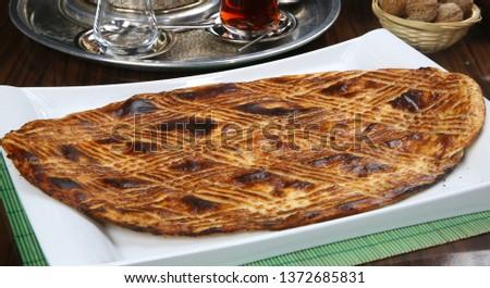 Traditional Turkish ramadan pita bread - Ramazan pidesi #1372685831