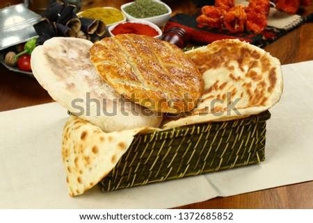 Traditional Turkish ramadan pita bread - Ramazan pidesi #1372685852
