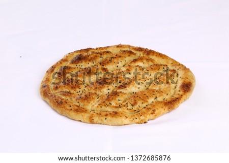 Traditional Turkish ramadan pita bread - Ramazan pidesi #1372685876