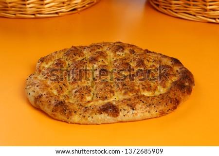 Traditional Turkish ramadan pita bread - Ramazan pidesi #1372685909