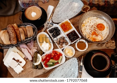 Traditional Turkish rich breakfast. A typical breakfast consists of cheese, butter, olives, eggs, tomatoes, cucumbers, jam, honey Photo stock ©