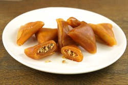 Traditional Turkish sweet pestil or  muska dessert with walnut .