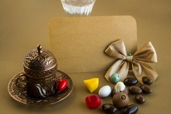 Traditional Turkish vintage coffee cup with colorful almond candies and an empty card for any celebration text.