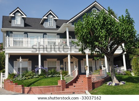 Traditional 2 two story house in blue - stock photo