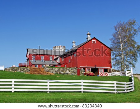 Traditional typical looking American building with white fence