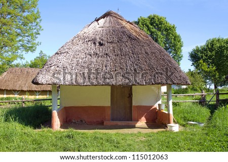 Traditional ukrainian rural house with a straw roof