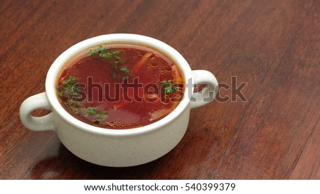 Traditional Ukrainian Russian vegetable borscht on the old wooden background #540399379