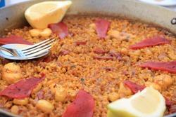 Traditional Valencian meal Arroz a banda with seafood, Denia, Spain