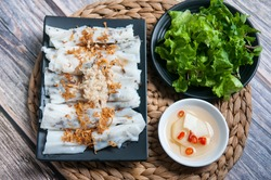 Traditional Vietnamese dish - Banh Cuon, Vietnamese steam rice rolls with fish sauce and vegetables