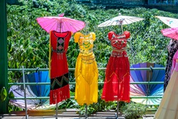 Traditional Vietnamese dress on display in Dalat, Vietnam, close up