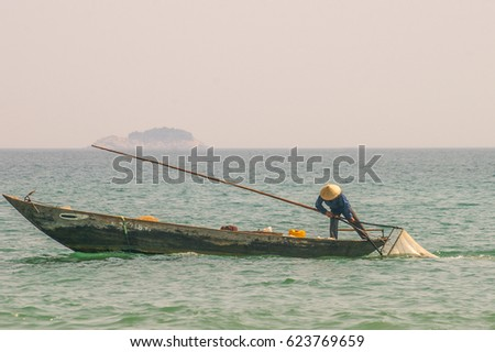 Traditional Vietnamese fishing along the beautiful coastline of Vietnam #623769659