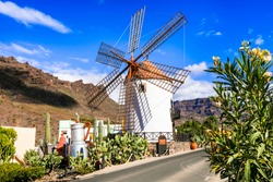 Traditional village Mogan with old windmill , Canary island. Grand Canary