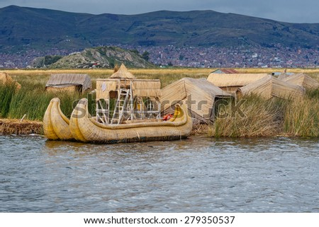 Traditional village on floating Uros  islands on lake Titicaca in Peru, South America  #279350537