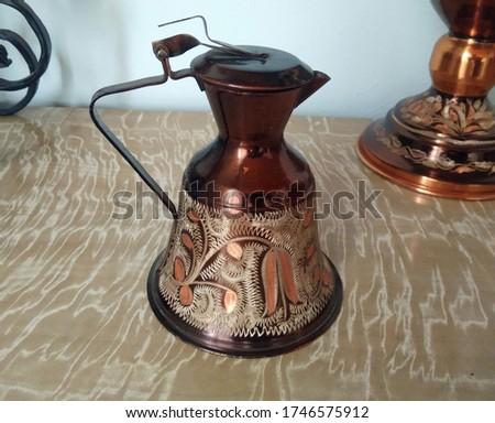 Traditional vintage copper pitcher closeup Stok fotoğraf ©