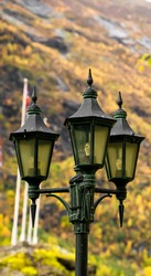 Traditional vintage lamp post made from black cast iron.