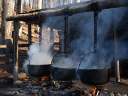 Traditional way of making maple syrup by boiling the sap in a cauldron