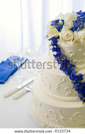 stock photo traditional wedding cake decorated with blue delphiniums and