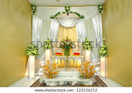 traditional wedding stage with yellow decoration