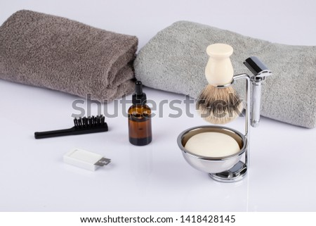 Traditional wet shaving. Shaving brush, safety razor, beard oil and soap.