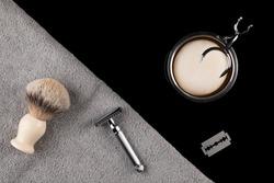 Traditional wet shaving. Shaving brush, safety razor, towel and soap.