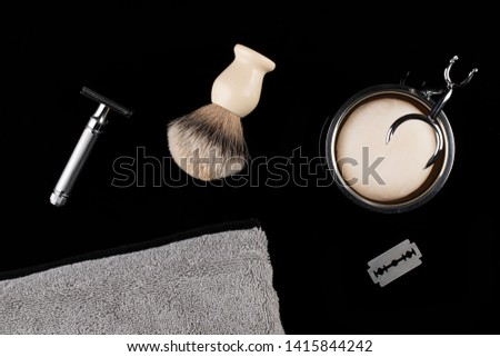 Traditional wet shaving. Shaving brush, safety razor, towel and soap.