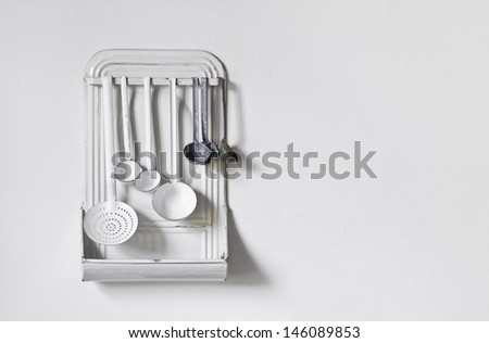 stock-photo-traditional-white-and-blue-enamel-kitchen-cooking-spoons-and-ladle-on-white-wall-background-as-146089853.jpg