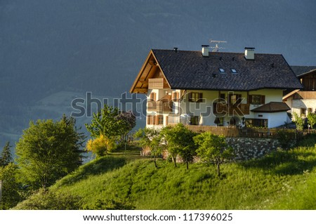 Traditional white chalet in Tyrol region of Italy