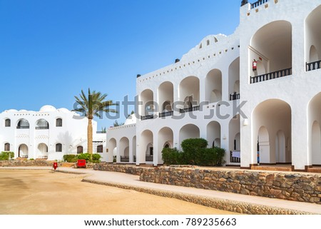 Traditional white egyptian architecture in Hurghada harbor #789235663