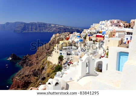 Traditional white houses of Santorini village and spectacular view to volcanic bay, Greece