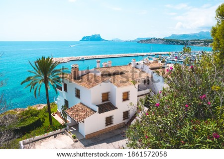 Traditional white houses with unspoiled idyllic view of marina, coastline and Mediterranean Sea in Moraira, Costa Blanca, Spain