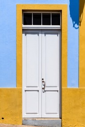 Traditional white painted door in canarian colonial style house in the old town of Santa Cruz de La Palma, in the quarter of San Sebastian, also also known as La Canela