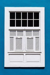 Traditional white painted window in canarian colonial style house in the old town of Santa Cruz de La Palma, in the quarter of San Sebastian, also known as La Canela