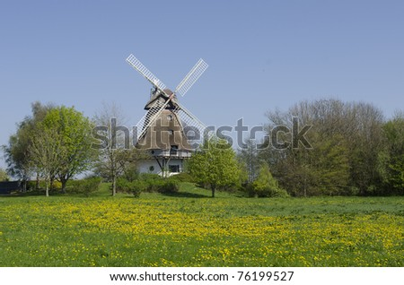 traditional windmill in schleswig-holstein,  Germany - stock photo