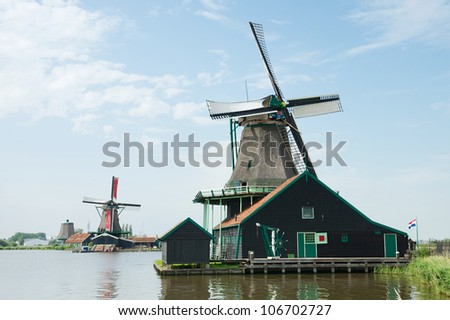 Traditional windmill near the river, Holland
