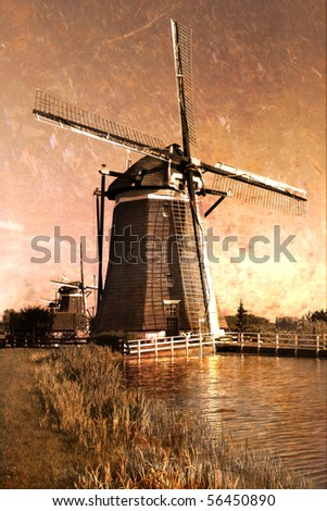 Traditional windmills  on the country side of Holland. Old Postcard.