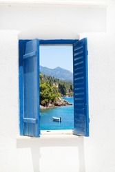 Traditional window with sea view at Halkidiki peninsula, Greece