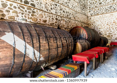 Traditional Wine Cellar with Huge Wine Barrels in the Historic City of Melnik, Bulgaria.
