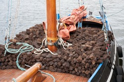 Traditional wooden boat Galway Hooker, loaded with turf.