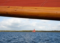 Traditional Wooden Boat, with red sail. Detail.